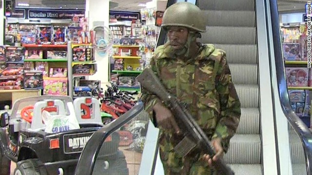 An image grab taken from AFP TV shows military forces taking position inside a shopping mall following an attack by masked gunmen in Nairobi on September 21, 2013