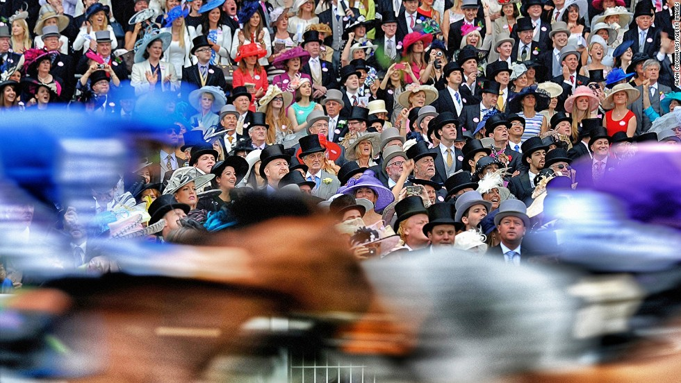 "<strong>Royal Ascot, Ascot, Berkshire, UK:</strong> Runners pass the grandstand in the Ascot Stakes during day one of Royal Ascot. ""You can't really go too far wrong. It's always nice colors, smart clothing,"" added Crowhurst."