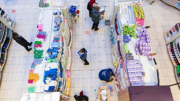 Shoppers browse goods for sale in the toiletries section of Nakumatt.