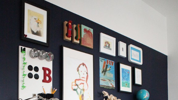 Katja Kromann created this gallery wall with floating bookshelves for her son's room. To find out more about the decorative elements she used, ask in the comments section.