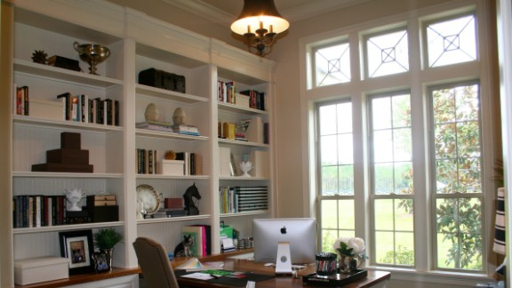 Lori Evans said she often stood back to check the balance of decor in the built-in bookcase in her home office as she filled it with accessories and books. Her prized treasure on the shelves is a signed Tim Tebow button. Want to know more? Ask Evans in the comments section.