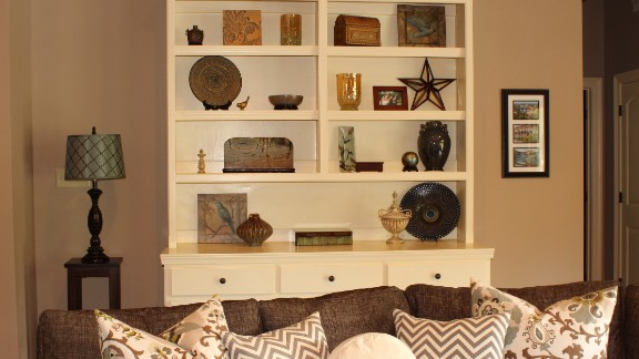 Tiffani Stutzman's decorated bookshelf is full of items that have special meaning to her, including the wooden box her brother carved. To learn more about her shelf decorating philosophy, ask Stutzman in the comments section.