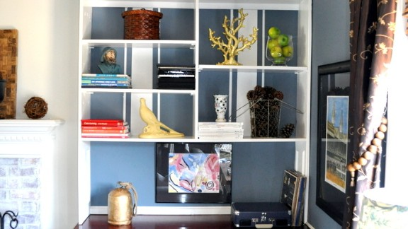 Tracie Stoll created a striped paint treatment to add interest to her built-in bookshelves, but her focus is mainly captured by the family heirlooms on the shelves. To find out more about the paint treatment, ask Stoll in the comments section below.