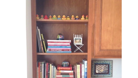 Andrea Trbovich's bookshelf wasn't necessarily her style, but she said the colors, shapes and textures of her book collection always draws her in. Are you in the same boat? Discuss your bookshelf decorating dilemmas in the comments section below.