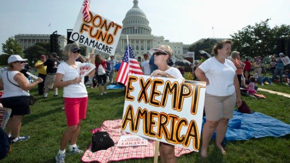 "Linda Norman, right, and Joanna Galt, both from Florida, hold their banners during a ""Exempt America from Obamacare"" rally on the West Lawn of the Capitol in Washington, Tuesday, Sept. 10, 2013. (AP Photo/Manuel Balce Ceneta)"