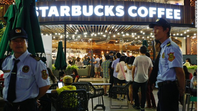 Even in Vietnmam, a global coffee capital, customers lined up to be the first to hold a cup sporting the iconic twin-tailed mermaid on the opening day of the first Starbucks outlet in Ho Chi Minh City on February 1, 2013.