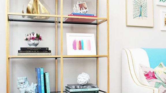 Jana Bek loves the brass boats on the top shelf of this bookcase. Are you also a sucker for objects that shimmer? Ask Bek where she finds affordable and unusual decor in the comment section.