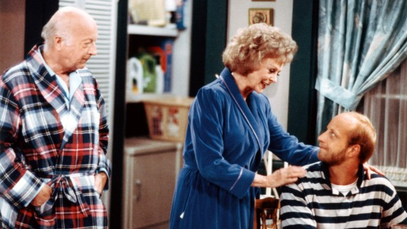 """The short-lived 1980s sitcom """"Get a Life"""" starred Chris Elliott (seated), his real-life father Bob Elliott and June Lockhart. Chris Elliott's character was a 30-year-old man with a paper route who lived in an apartment above his parents' garage."""