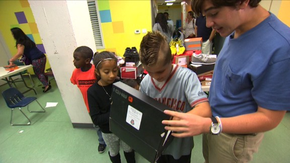 Nicholas Lowinger often brings the donated shoes right to the children himself.