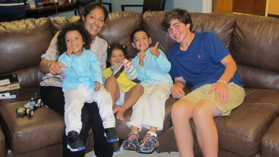 Frencis Velasquez's three children received new shoes from Nicholas Lowinger, right.