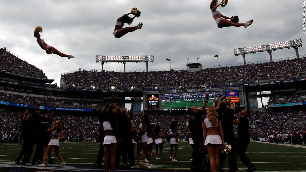 Is it a bird or is a plane? No it is the Baltimore Ravens cheerleaders performing during the second half of the game against the Houston Texans.