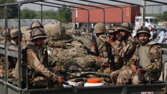 Members of Pakistan's army prepare to travel to Balochistan province from Karachi on September 25.