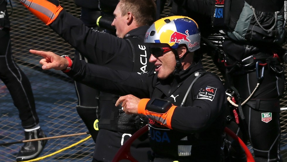 Oracle Team USA skipper Jimmy Spithill celebrates the victory following the race's dramatic conclusion.