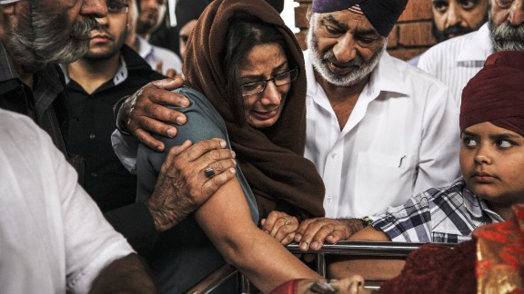 Members of the Kenyan Sikh community cremate a woman and boy on September 25.