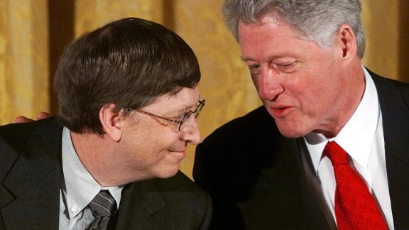 "Gates and former U.S. President Bill Clinton attend a White House conference on ""the New Economy"" in April 2000."