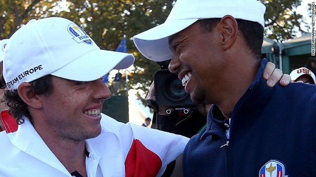 Tiger Woods (right) congratulates Europe's Rory McIlroy after the 39th Ryder Cup at Medinah.