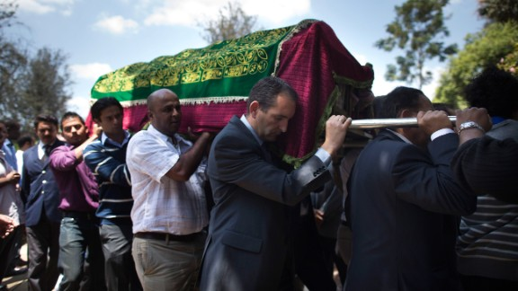 Relatives and friends carry the coffin of Ruhila Adatia Sood, a Radio Africa television and radio presenter, during her funeral in Nairobi on September 26.