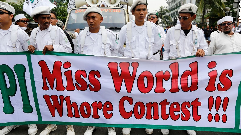 "Members of the conservative Islamic group, the Islamic Defenders Front held signs reading ""Tolak (Reject) Miss World"" and ""Miss World is Whore Contest"" in protest against the competition on September 3 in Jakarta, Indonesia."