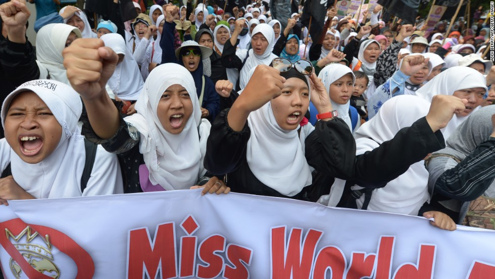 "Female Muslim protesters shout slogans during a protest against the Miss World beauty pageant contest outside its main sponsor office, MNCTV in Jakarta on September 5. Around 1,000 Islamic hardliners protested saying the event promoted ""smut and pornography."""