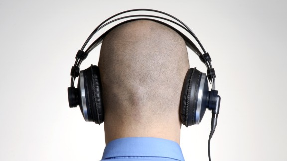 """Throw away the headphones -- magnets implanted inside the ear can now play music directly into your head. Rich Lee received a pair of """"internal headphones"""" last year."""