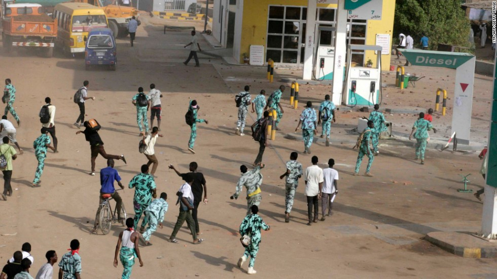 Sudanese protesters throw stones at a gas station in Khartoum's twin city of Omdurman on Wednesday. Sudan is among the countries where political violence continues to increase, Maplecroft said.