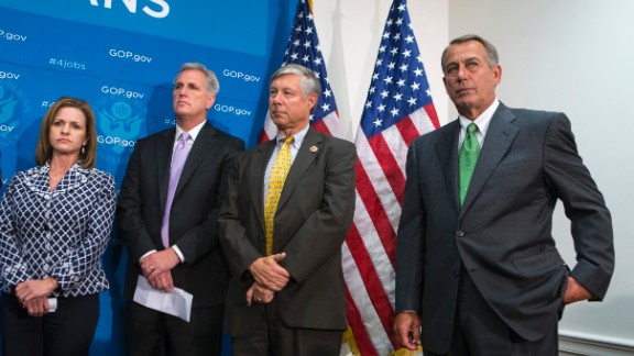 House Speaker John Boehner of Ohio, right, and House GOP leaders, participate in a news conference on Capitol Hill in Washington, Thursday, September 26, as pressure builds over legislation to prevent a partial government shutdown.