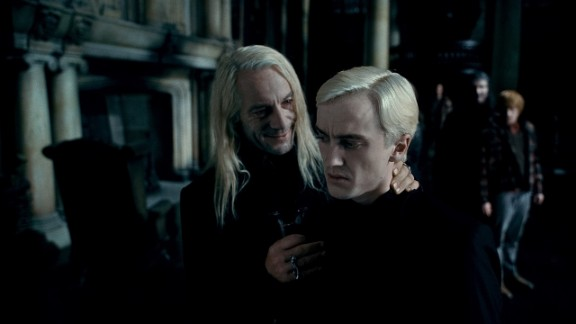 Jason Isaacs and Tom Felton as father-and-son bad guys Lucius and Draco Malfoy in the movie adaptation of Harry Potter and the Deathly Hallows.