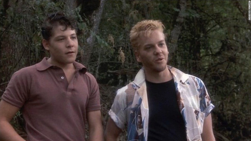 "Kiefer Sutherland, right, plays Ace Merrill, an older townie who gives the kids of the movie ""Stand By Me"" something else to fear as they go in search of a body."