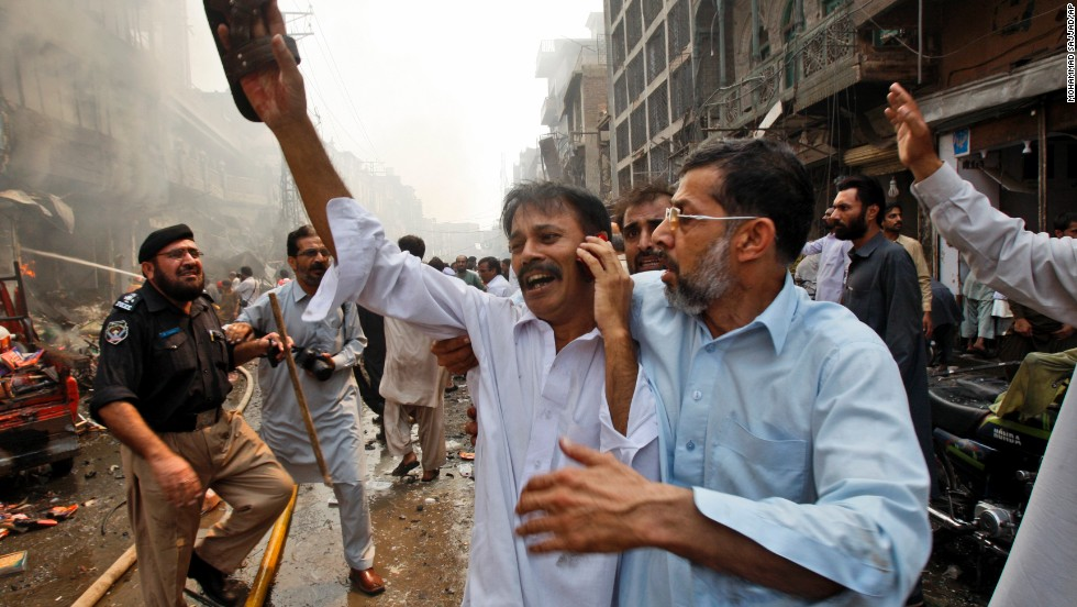 A man tries to make a phone call after the explosion.