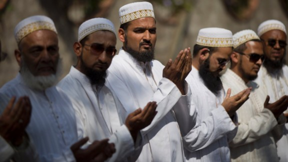 Muslim men pray at a memorial service outside the Westgate Mall on September 29.
