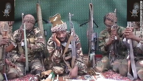 A man claiming to be the leader of Boko Haram, Abubakar Shekau, center, is seen in a video given to journalists in 2013.