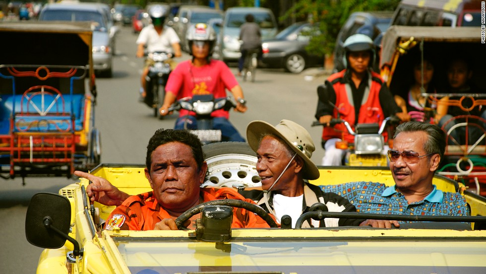 "<a href=""http://cnn.com/2013/09/29/world/asia/indonesia-act-of-killing-bali/"">""The Act of Killing,""</a> a 2012 documentary, follows unrepentant death squad leader Anwar Congo, center, as he and others reenact their violent acts from 48 years ago. It has had a big impact in Indonesia as the country struggles to address the anti-communist purges that led to an estimated 1 million deaths."