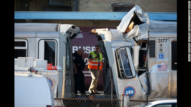 Emergency personnel investigate the scene where dozens of people were taken to hospitals after a CTA train ran head-on into another train that was stopped at a Blue Line station in Forest Park, Illinois, Monday, September 30, 2013. (Chuck Berman/ Chicago Tribune/MCT via Getty Images)