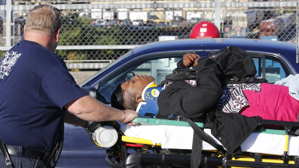 An injured rider is transported by emergency workers after the head-on collision on September 30.
