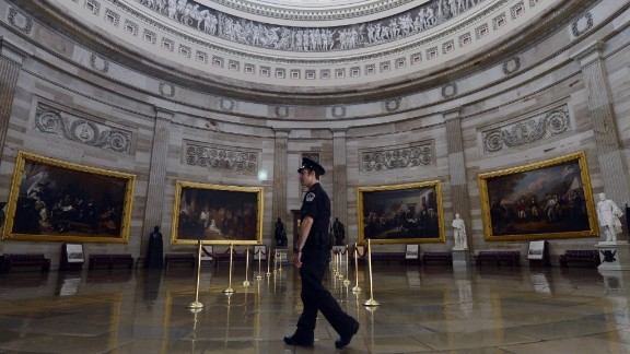 A Capitol police officer walks through the empty Capitol Rotunda, closed to tours during the government shutdown on Capitol Hill in Washington, on October 1.