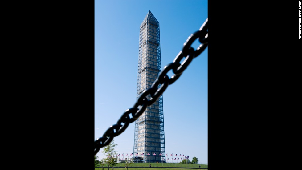 The Washington Monument is seen behind a chain fence in Washington, on October 1.