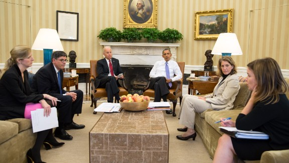President Barack Obama and Vice President Joe Biden listen as they are updated on the federal government shutdown and the approaching debt ceiling deadline, in the Oval Office, Oct. 1, 2013. From left, Kathryn Ruemmler, Counsel to the President, Treasury Secretary Jack Lew, Sylvia Mathews Burwell, Director of OMB, and Alyssa Mastromonaco, Deputy Chief of Staff.
