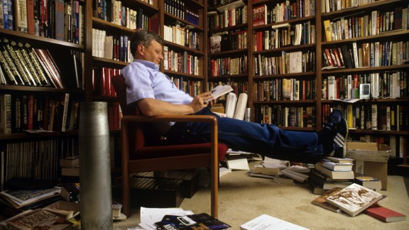 Clancy relaxes in his home library in Baltimore in 1988.
