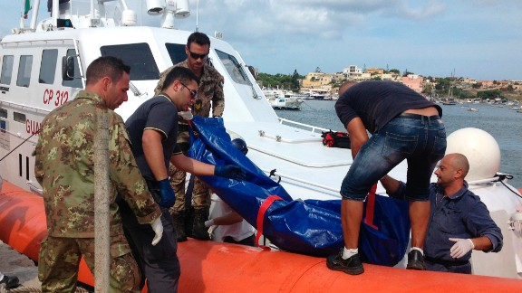 The body of a drowned migrant is being unloaded from a Coast Guard boat in the port of Lampedusa, Sicily, Thursday, Oct. 3, 2013. Tens of people died when a ship carrying African migrants toward Italy caught fire and sank off the Sicilian island of Lampedusa, spilling hundreds of passengers into the sea, officials said Thursday. Many migrants have been rescued, but the boat is believed to have been carrying as many as 500 people. It is one of the deadliest migrant shipwrecks in recent times and the second one this week off Italy: On Monday, 13 men drowned while trying to reach southern Sicily when their ship ran aground just a few meters (yards) from shore at Scicli. (AP Photo/Nino Randazzo, Health Care Service, HO)