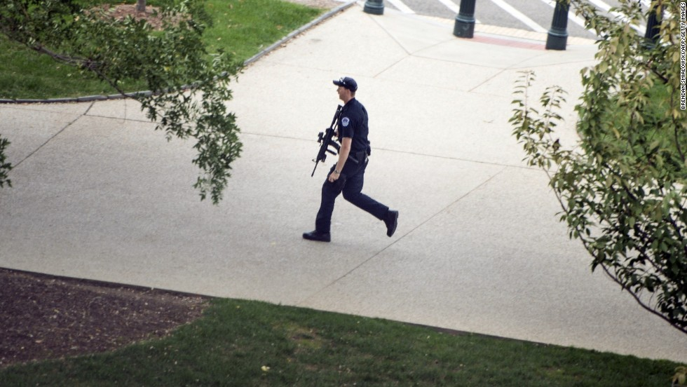 A police officer runs while reacting to a call of shots fired.