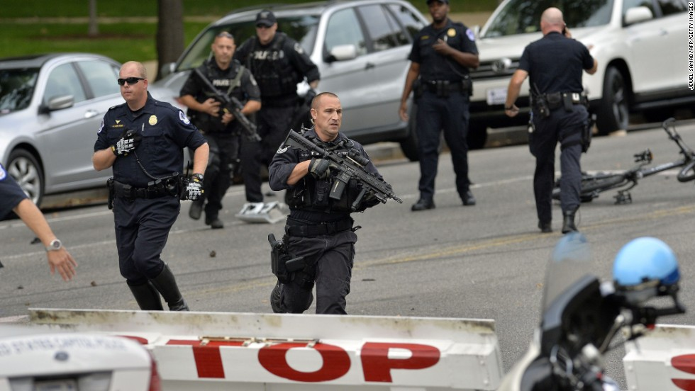 Police run near 2nd Street NW and Constitution Avenue in Washington on October 3.
