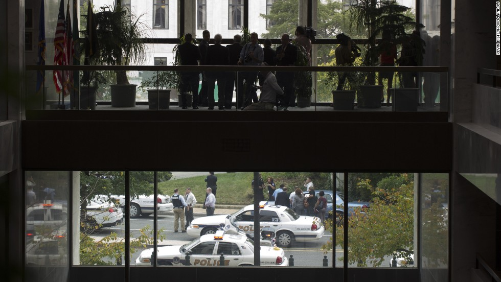 Members of the media watch as Capitol Hill Police respond to the report of shots fired.