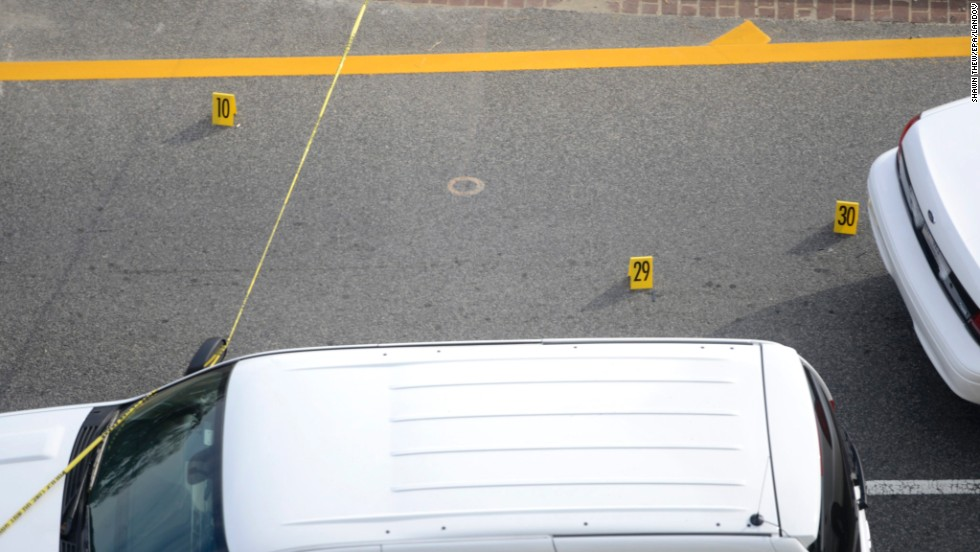 Police evidence markers are placed at the scene outside the U.S. Capitol.<br />