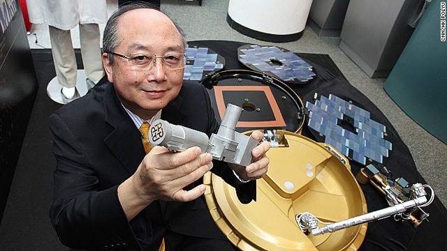 Professor Yung Kai-leung displays his Mars Rock Corer for the ESA's Mars Express Mission