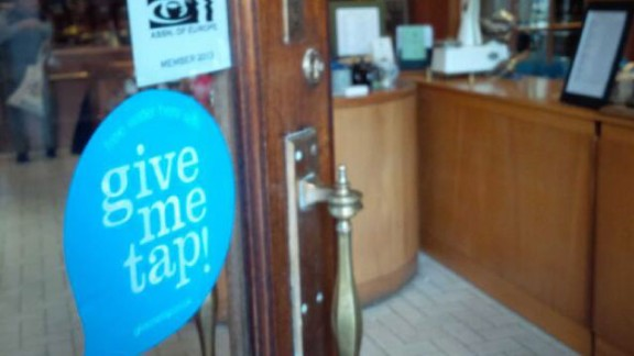 Cafes and restaurants participating in the free water refill scheme can let customers know by sticking GiveMeTap stickers on windows and doors, like H.R. Higgins Coffee in London. GiveMeTap has also developed an iPhone app that helps you find your nearest refill point in the UK.