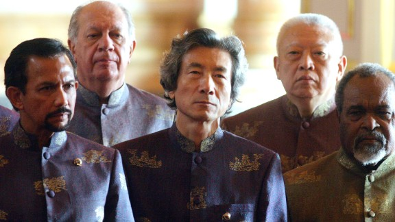 You'd think wearing a shirt of Thai silk spun with pure gold yarn would instantly make you a dashing figure. Yet only Japanese Prime Minister Junichiro Koizumi (center) seemed to truly live up to the fabric at APEC 2003 in Bangkok.