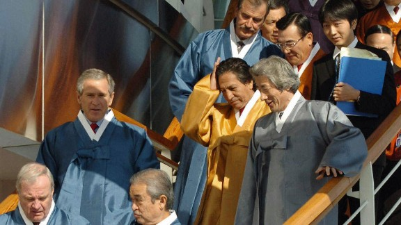 In Busan (2005), South Korea, APEC members agreed to confront pandemic health threats, such as bird flu, and to appear not at all uncomfortable with the high-waisted flair of traditional Korean hanbok.