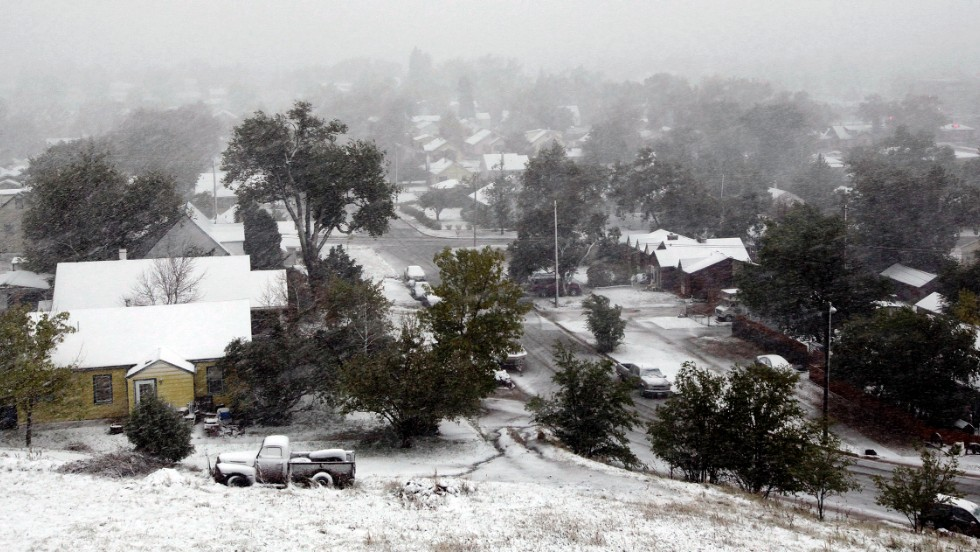 Snow blankets a neighborhood on October 4 in Rapid City, South Dakota.