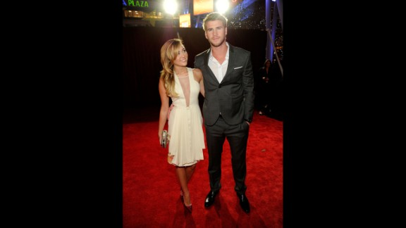Cyrus and Liam Hemsworth arrive at the 2012 People