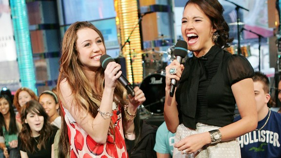 Cyrus chats with VJ Susie Castillo during an appearance on MTV